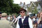 Elegantly dressed participants gather on The Grove for the tweed ride on Saturday