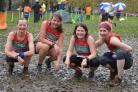 Ilkley Harriers Nicky Hopwood, Gaenor Coy, Julie Elmes and Petra Bijsterveld enjoyed the mud at Keighley Picture: Dave Woodhead