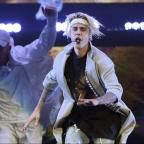 Ilkley Gazette: Watch Justin Bieber's brutal on-stage fall as he slips and lands in a puddle