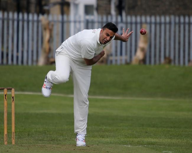 Nasir Chowdrey on his way to taking 6-28 for Jer Lane in their opening-day victory over Mytholmroyd in the Spenser Wilson Halifax League.