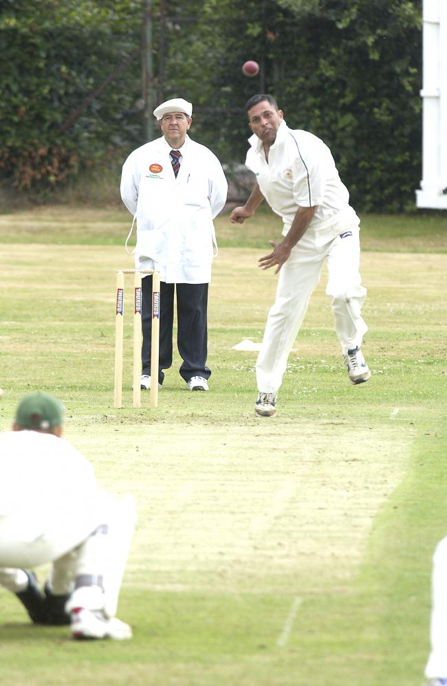 Baildons Mushtaq Ahmed bowling at Pudsey St Lawrence on Sunday pic PB.