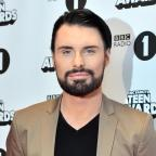 Ilkley Gazette: New game show Babushka will not replace The Chase, insists host Rylan Clark-Neal