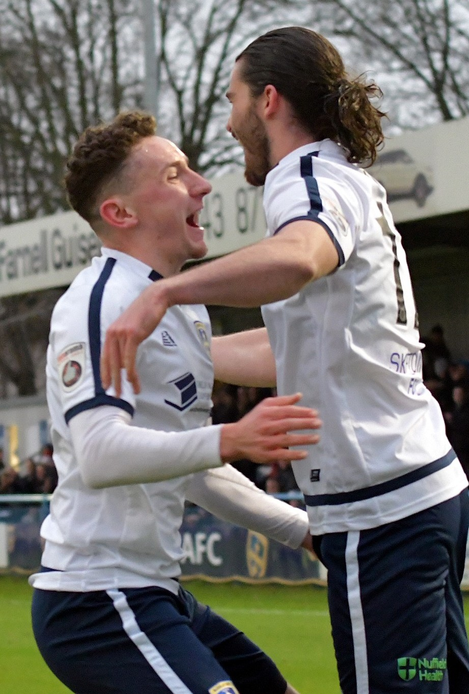Alex Purver, right, is congratulated by Callum McFadzean after scoring against Aldershot in Saturday's 1-1 draw at Nethermoor