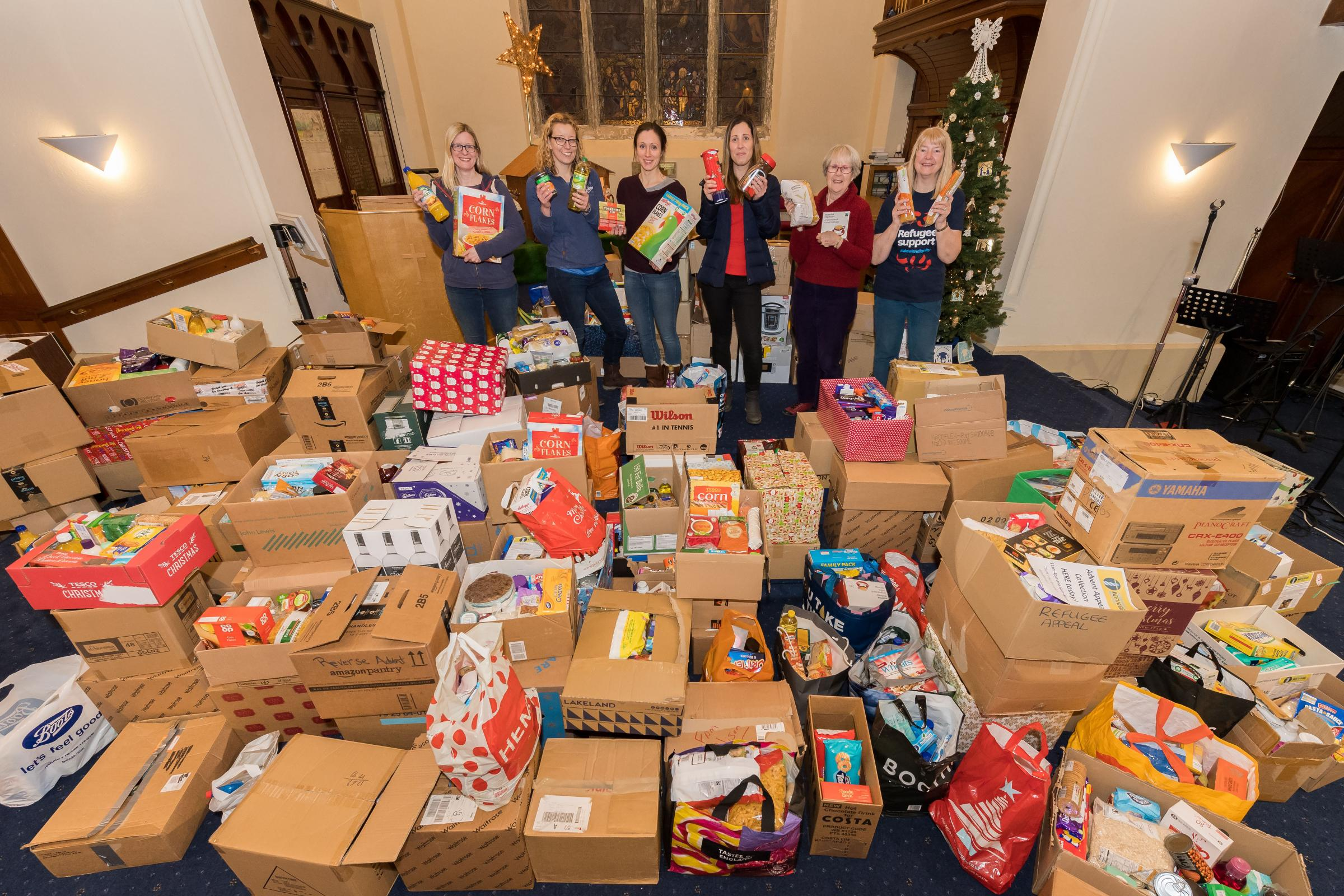 Wharfedale Refugee Response with the collection for the Reverse Advent Calendar Appeal at Burley In Wharfedale Methodist Church. Pictured left to right are: Catherine MacIntosh Dixon - Sarah Bruce - Sarah Mahony (organiser) - Stephanie Hull - Gillian MacI