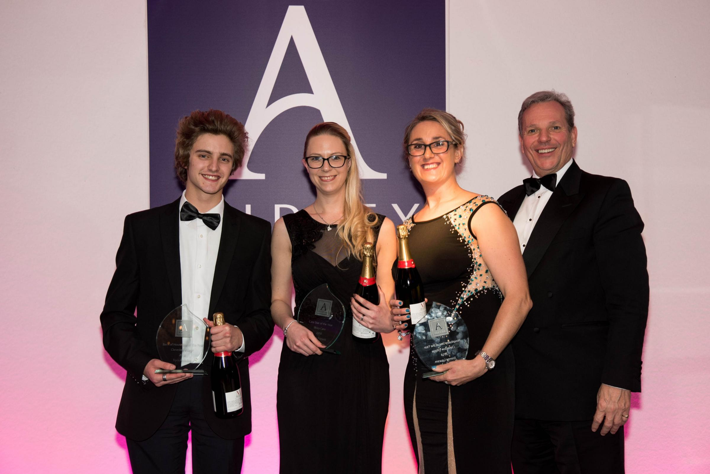 Pictured with their awards are from the left Tom Holliday, Robyn Forrest and Emma-Louise Fawcitt with Nick Sanderson, CEO of the Audley Group