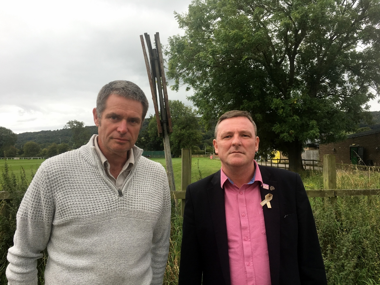Councillors Ryk Downes and Sandy Lay by part of the proposed 'East of Otley' development site