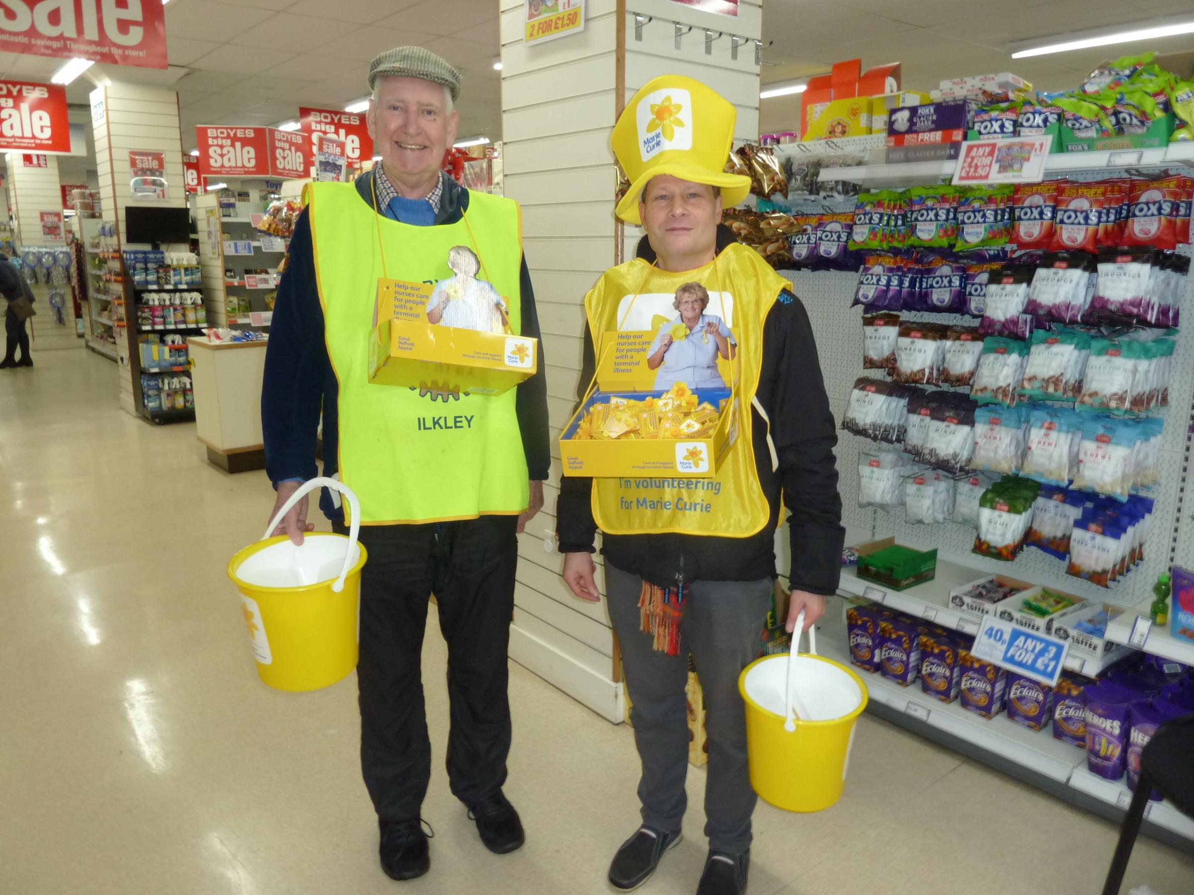 Andrew Allison and David Shaw, members of The Rotary Club of Ilkley, taking part in the Marie Curie collection in Boyes, Ilkley