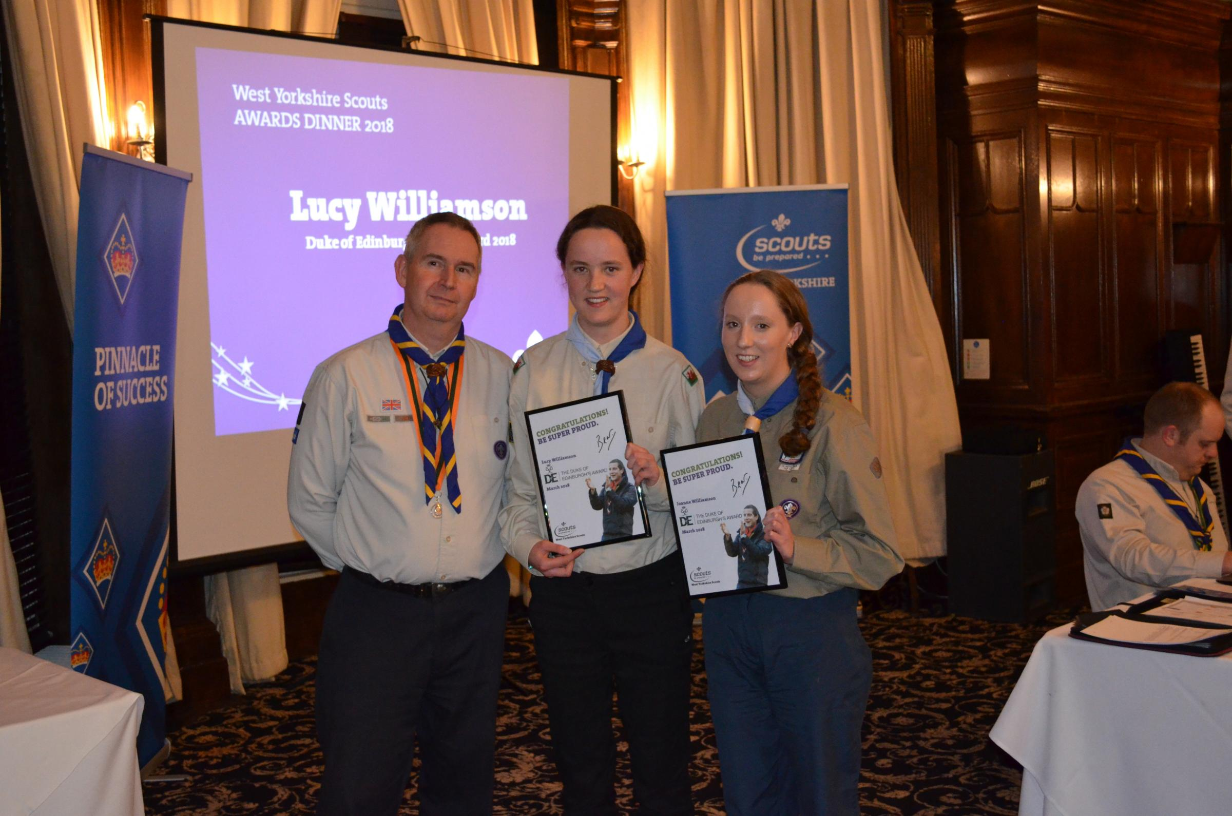Mark Stageman, the Scout County Commissioner of West Yorkshire make the presentation to Joanne and Lucy Williamson
