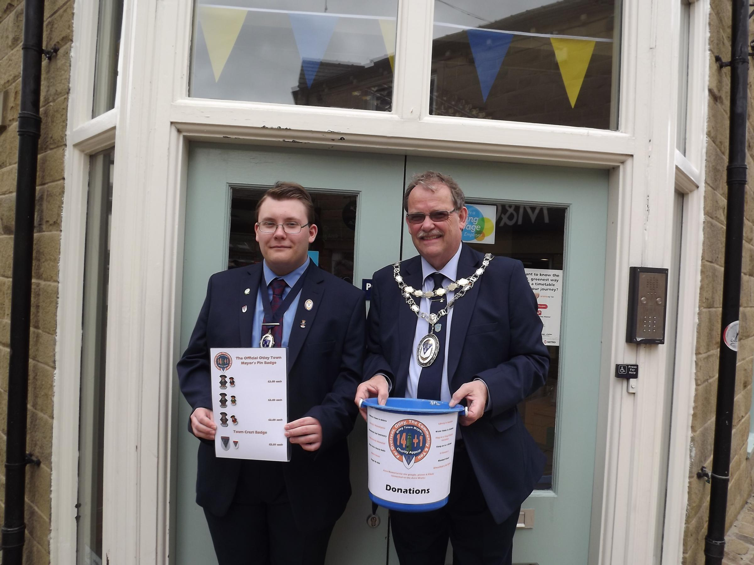 Otley Town Mayor Councillor Nigel Francis (right) with Consort and son Callum, sporting their new fundraiising Otley badges.