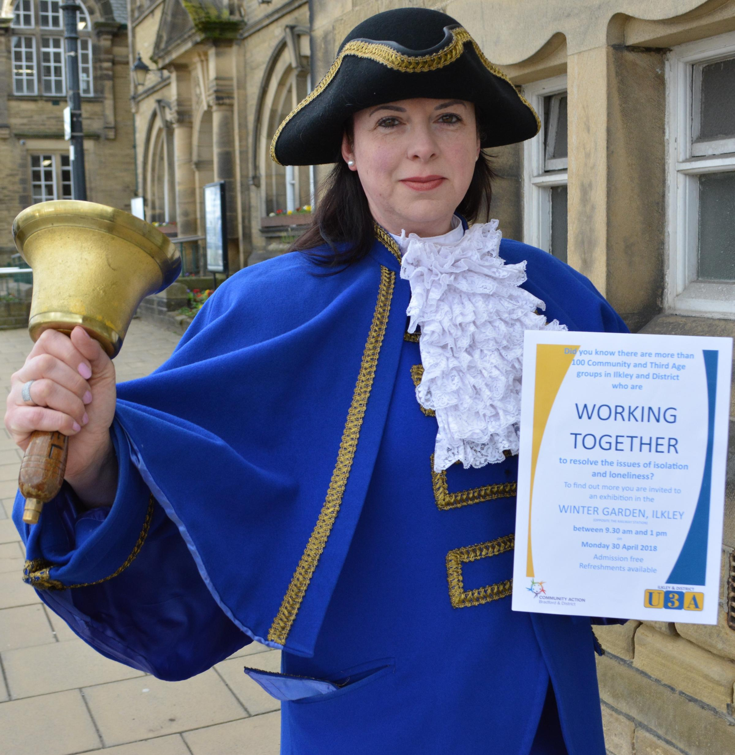 Ilkley Town Crier Isabel Ashman publicising a forthcoming exhibition aimed at tackling social isolation