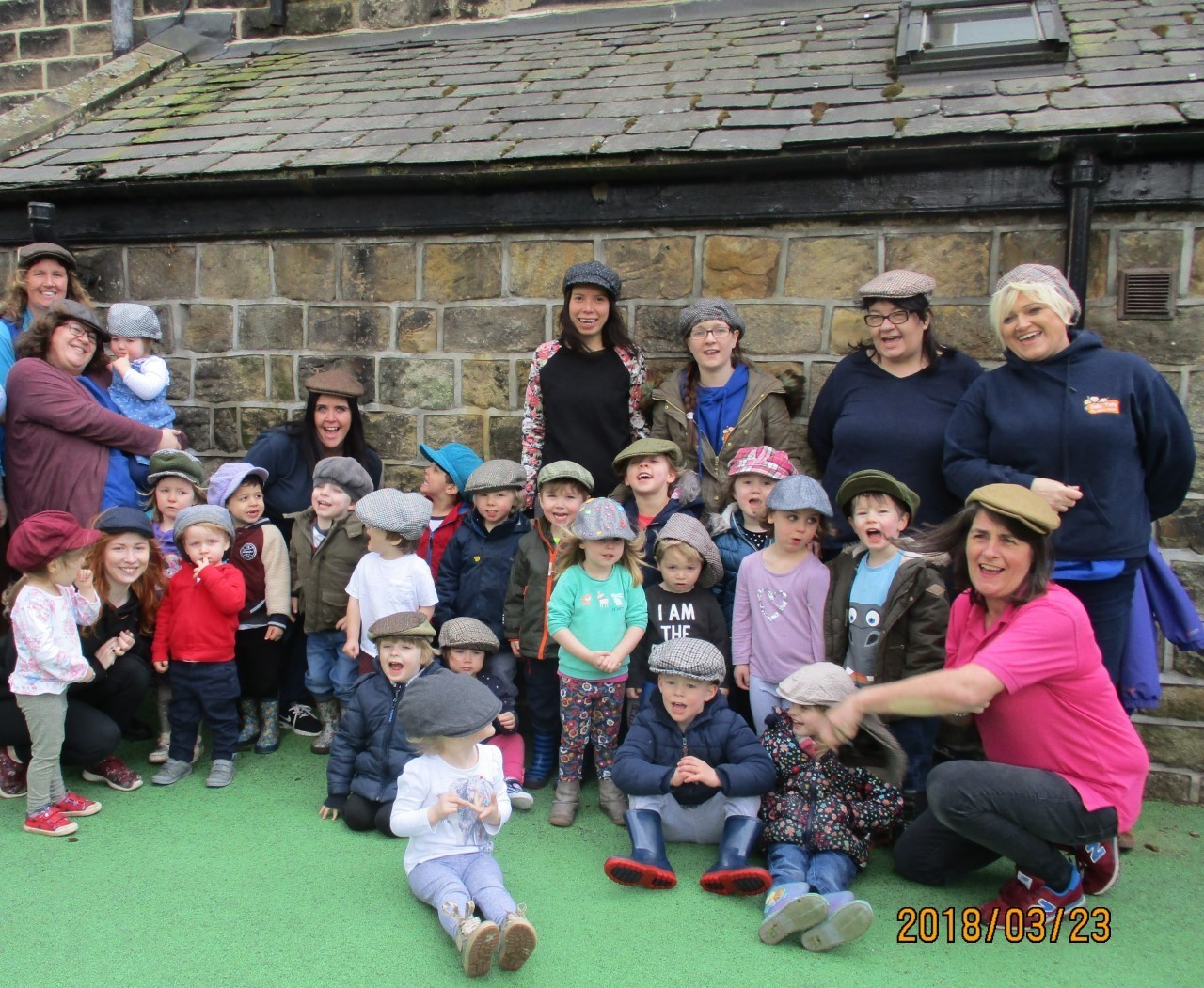 Children and staff at Jolly Tots Pre School Nursery, Burley-in-Wharfedale, enoying 'Flat Cap Friday'