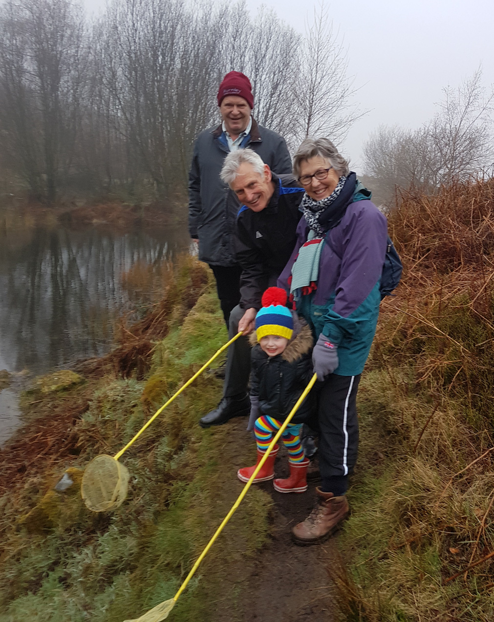 Mary and Philip Hall with grandson Leo Hall and David Whitehead (Friends of Ilkley Moor) at the upper tarn on the Newts Survey