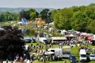 Big crowds out enjoying the sunshine and stalls by the lakeside at the 2018 Otley Show
