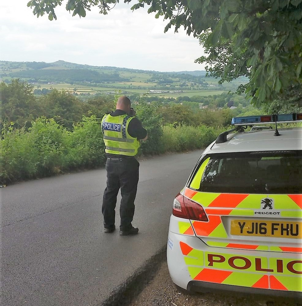 A police officer monitoring Old Pool Bank - the road is access-only but is frequently used by 'rat runners'. Photograph by West Yorkshire Police