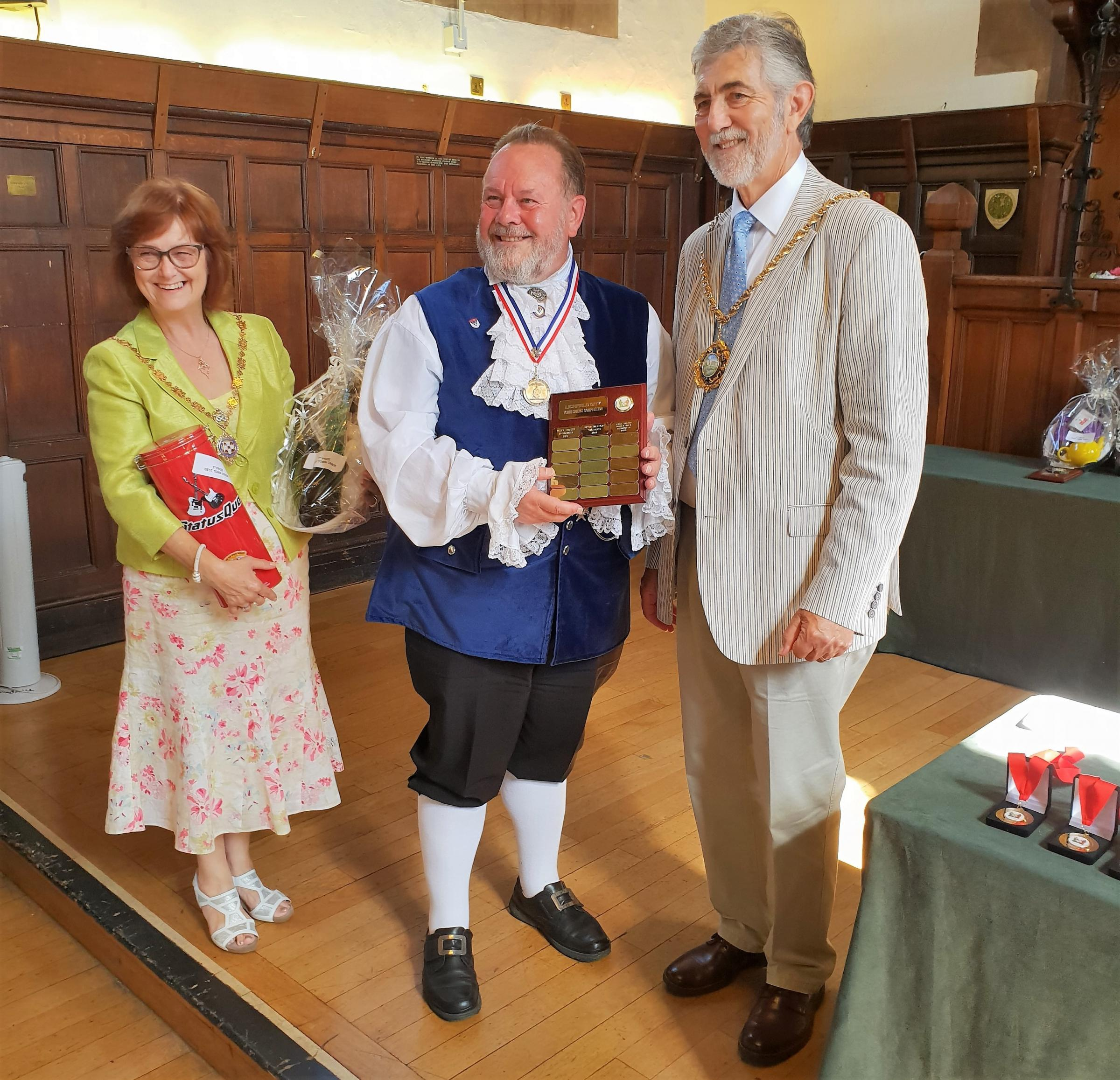 Otley Bellman Terry Ford, centre, receiving the Lichfield Town Crier Competition 2018 winner's trophy from the Worshipful Mayor of Lichfield, Councillor David Leytham, and Mayoress Councillor Jan Leytham-Gain