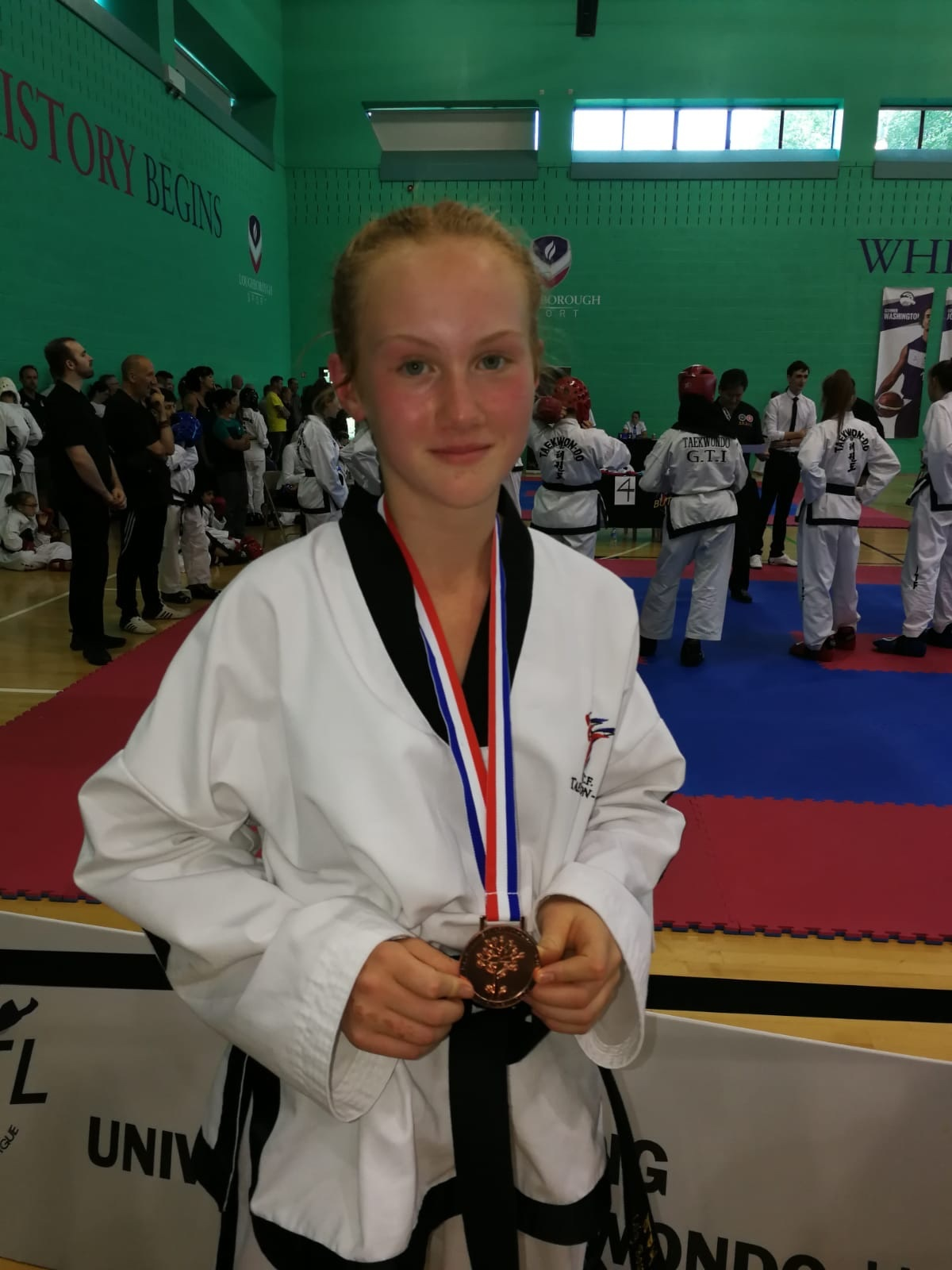 Celebrating her first medal as a black belt - 13 year old Wharfedale School of Tae Kwon-do member, Lily Boswell