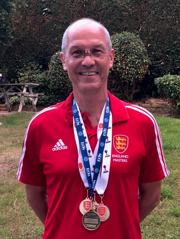 "Andy Locke with his clean sweep of national and international medals as well as a ""new nose"" Picture: Exin Masters World Cup 2018"