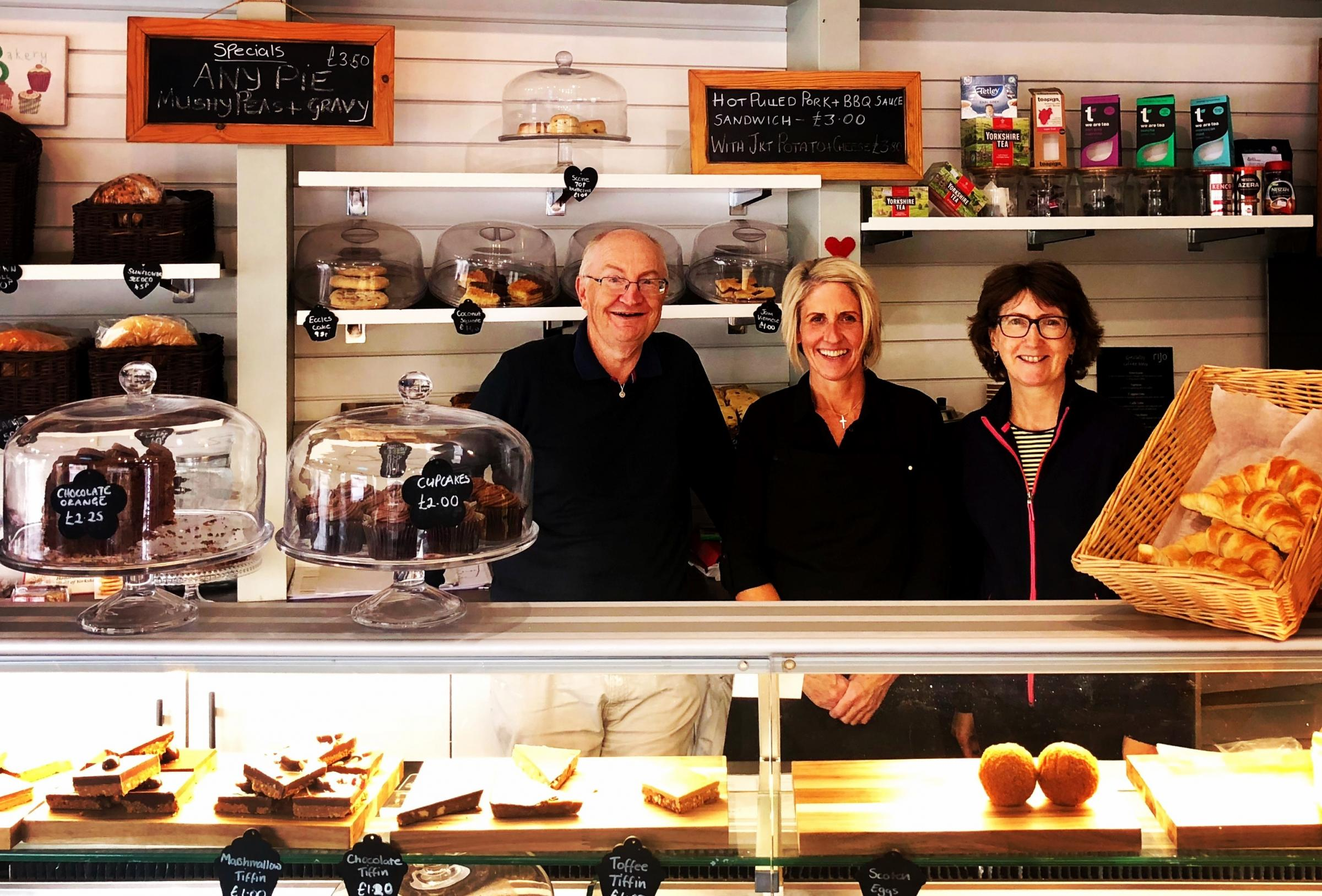 Councillors Barry and Caroline Anderson with shop manager Sally Kenny (centre) atThe Village Bakery, Bramhope
