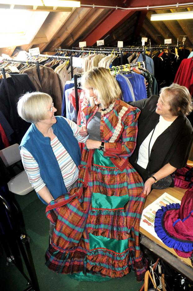 Yvette Huddleston gets a fitting from wardrobe mistress Pat Wildman and Joan Durkin.