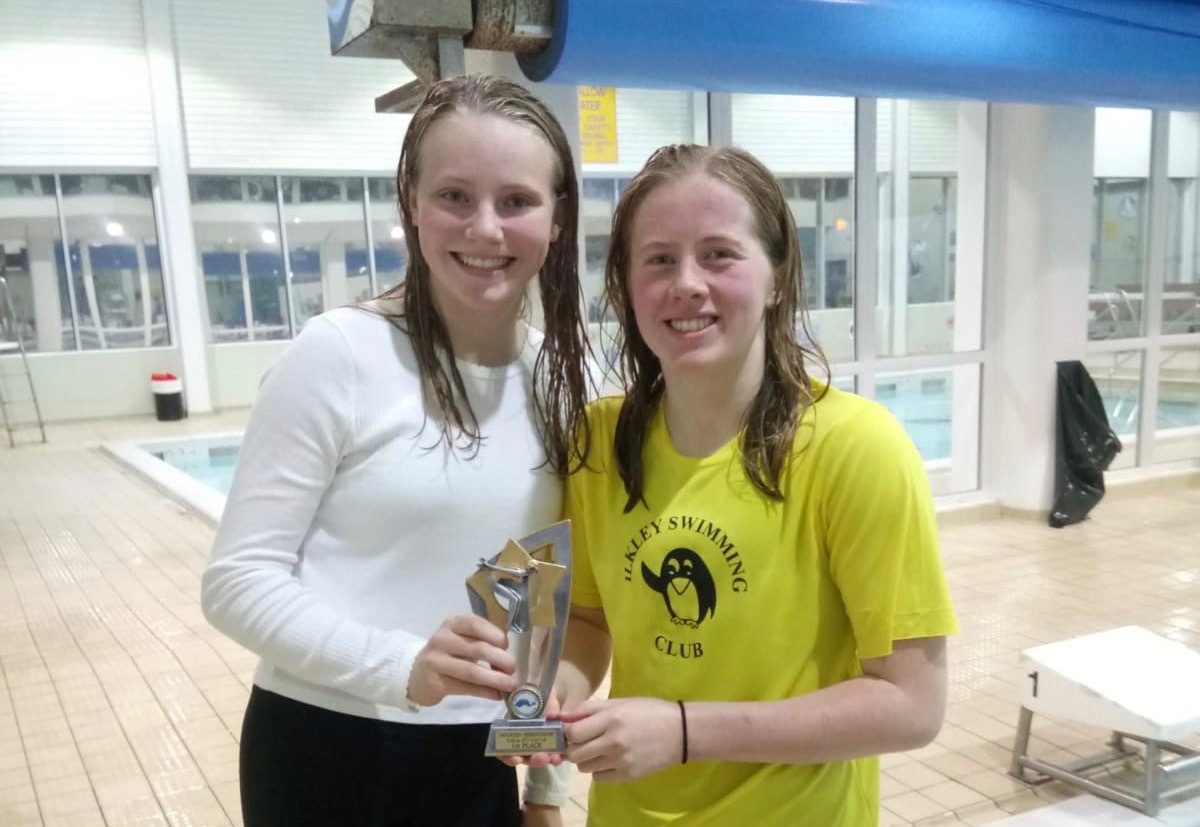 Pictured is Lottie and Ellen, two of the swimmers, with the trophy.