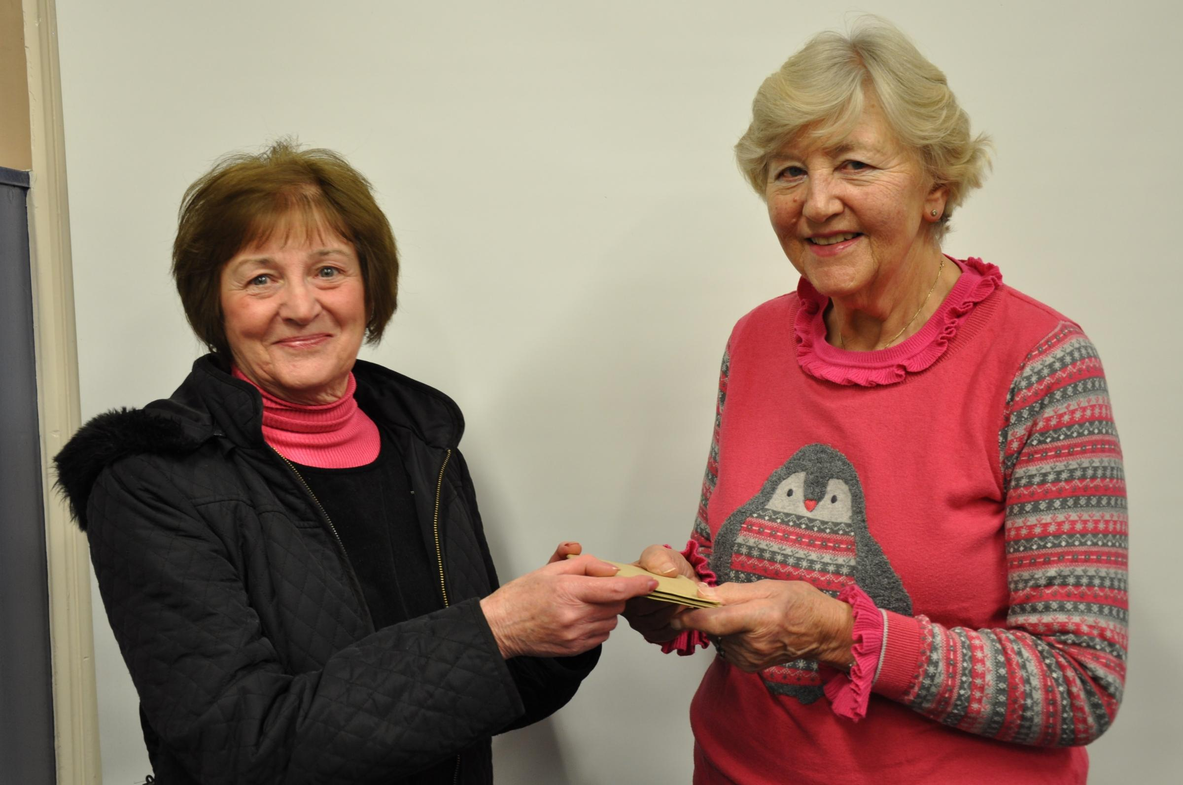 President of Menston Arts Club Anne Wade (pictured right) presents a cheque for £150 to Judith Knaggs of Help for Heroes