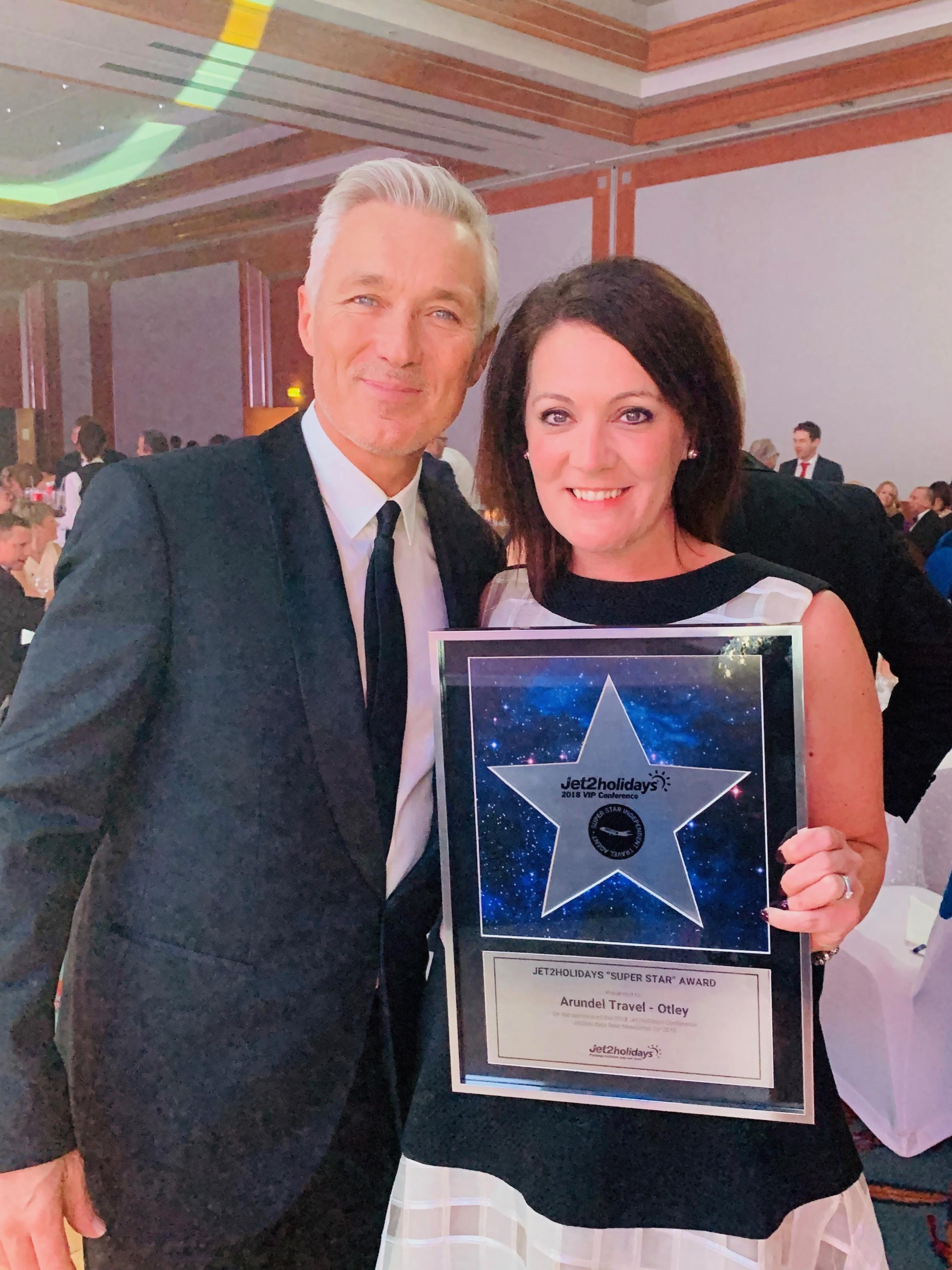 Helen Parry of Otley firm Arundel Travel receiving the Jet2holidays Best Newcomer Award from Martin Kemp