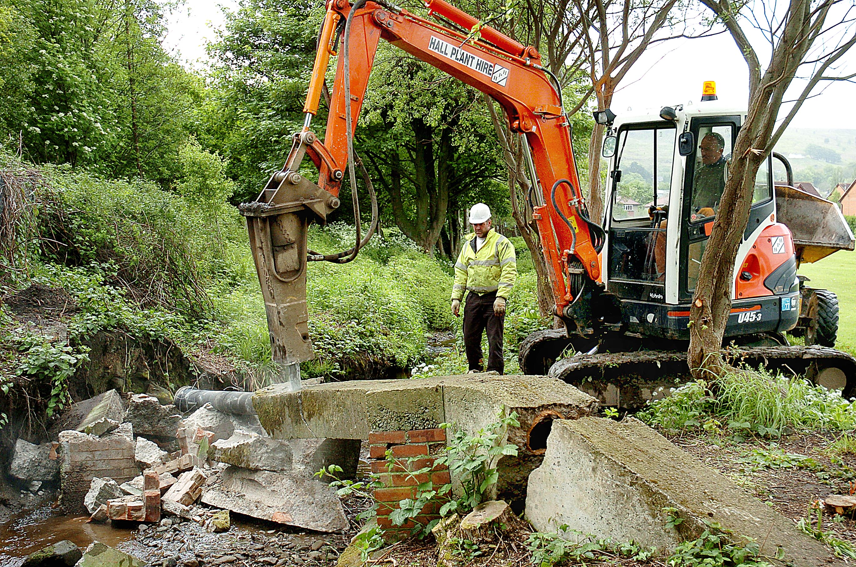 A digger starts work on Backstone Beck.