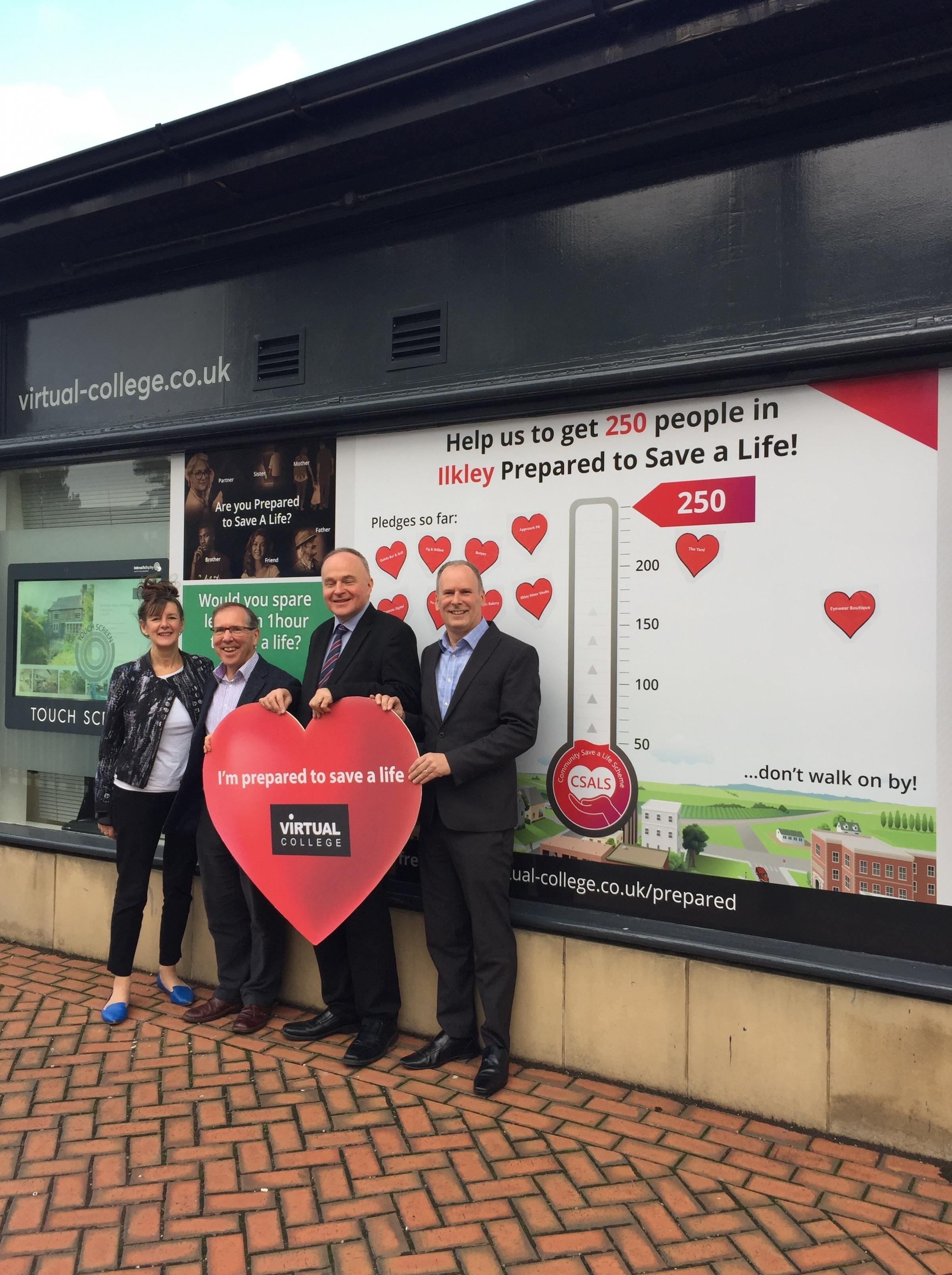 Pictured outside the Ilkley head office of Virtual College. from right to left are Rod Knox, CEO of Virtual College, John Grogan MP, and Bob Gomersall and Lesley Ord from Virtual College