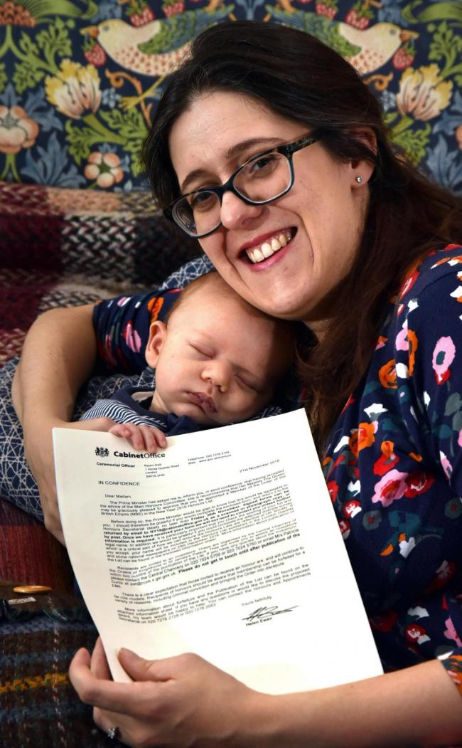 Architect Stefanie Stead and six-week-old Joseph with her MBE announcement letter