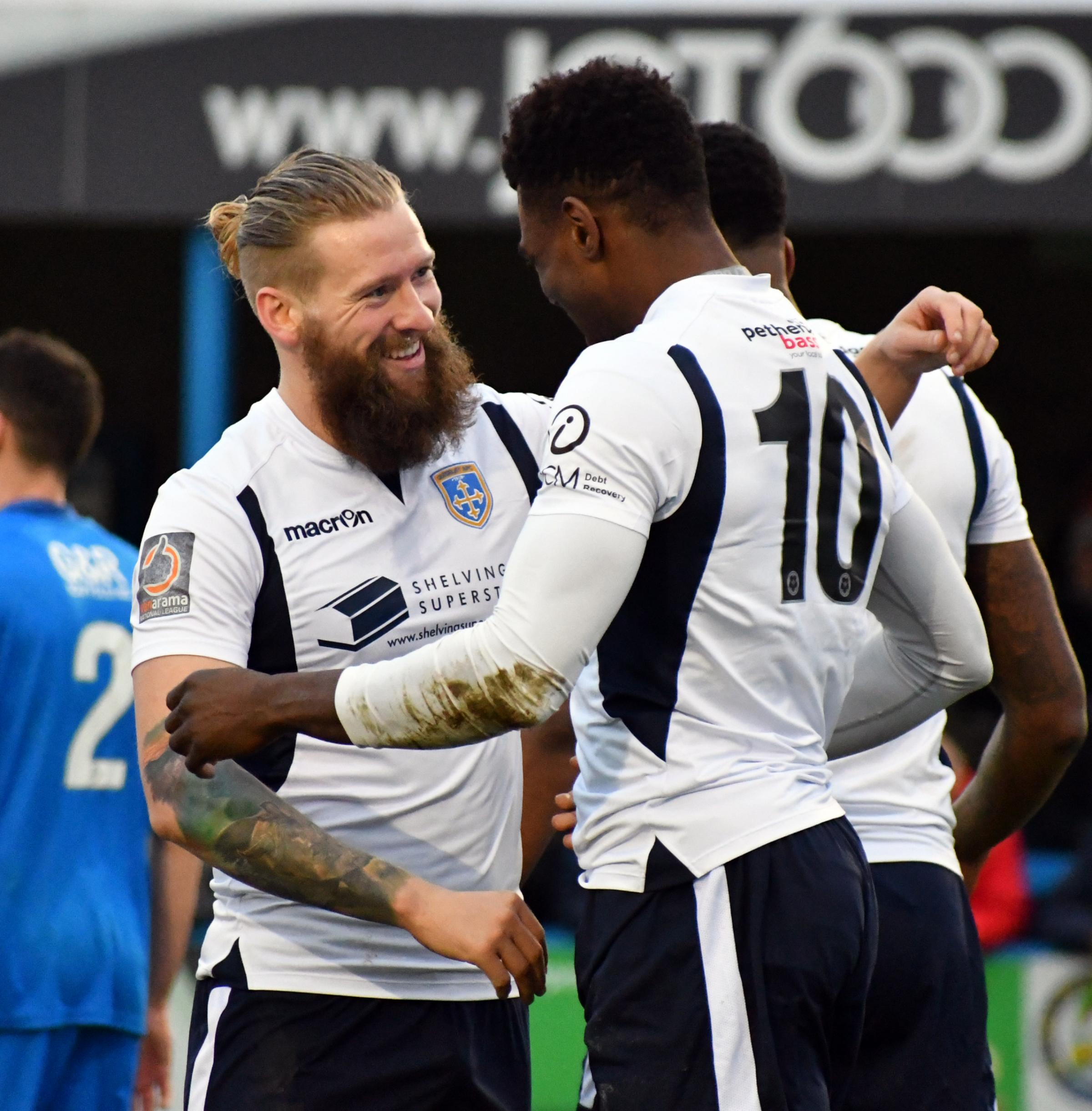 Goalscorer Kayode Odejayi is congratulated by Guiseley team-mate Alex Purver in their side's 1-1 draw with Leamington at Nethermoor in Vanarama National League North on Saturday. Picture: Richard Leach