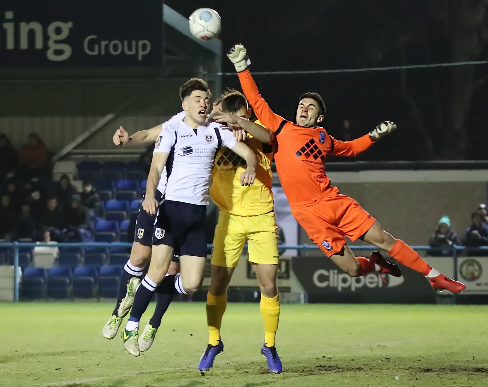 Guiseley midfielder George Cantrill, left, battles with Hereford goalkeeper Matt Yates during their 1-1 draw in the Vanarama National League North on Tuesday night. Picture: Alex Daniel Photography