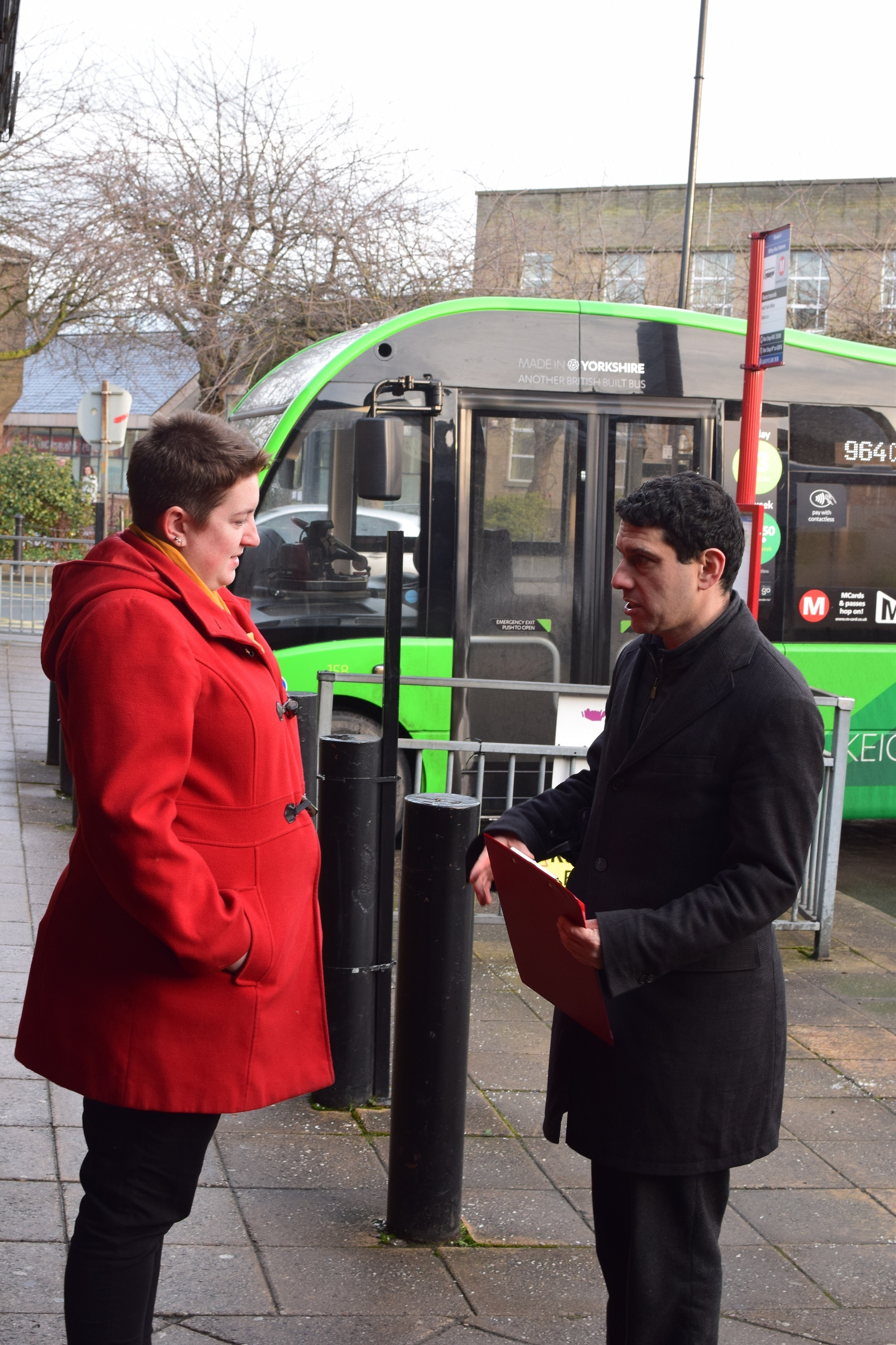 MP Alex Sobel in discussion with a passenger at Otley Bus Station