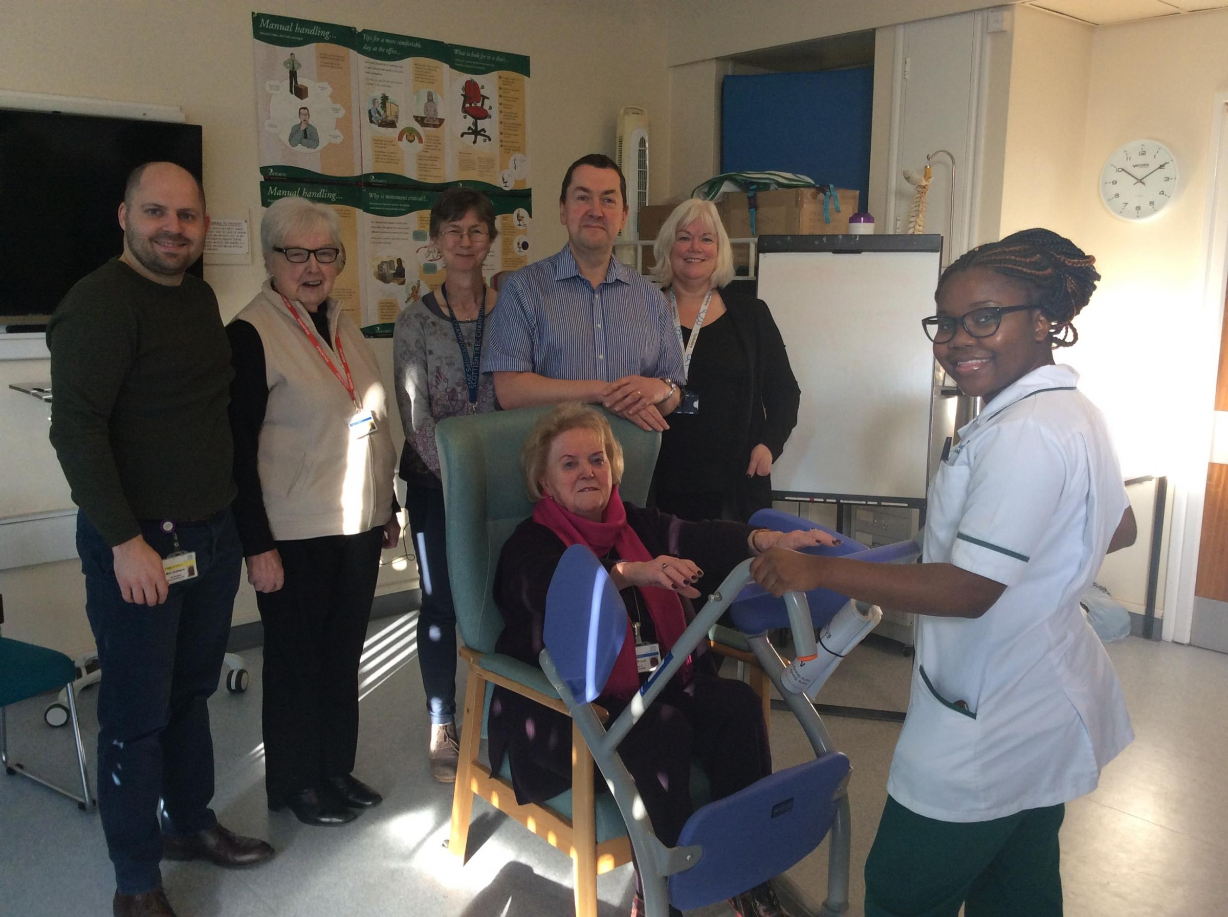 Friends of Airedale president Eileen Proud tries out one of the stands. With her are, from left, Matt Dickinson, learning and development facilitator at the trust; Betty Perry, secretary of the Friends; Dr Meg Crossley, consultant in emergency medicine; M