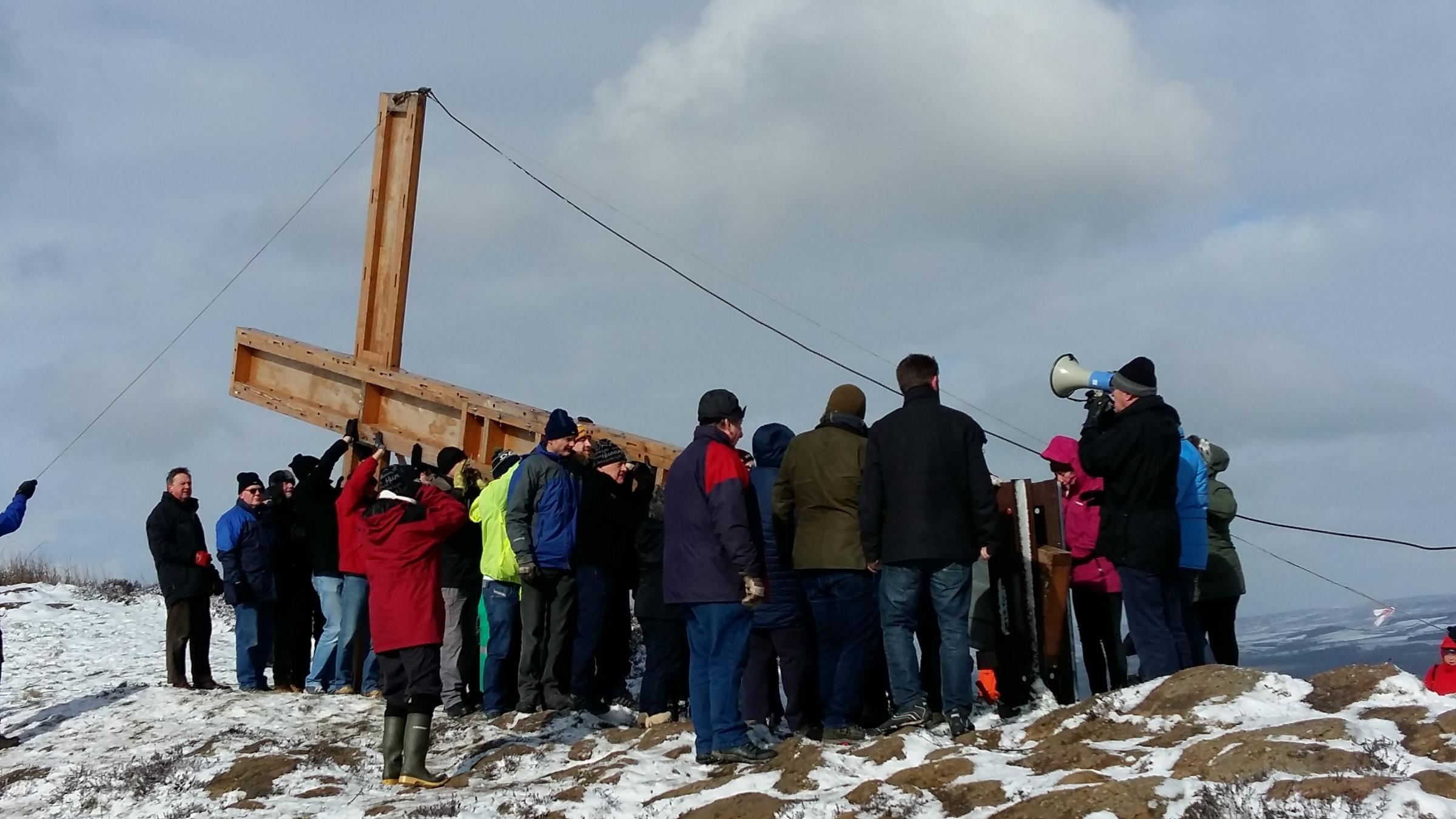 The Chevin Cross being carried into position on Otley Chevin. Photograph by Christine Hodson