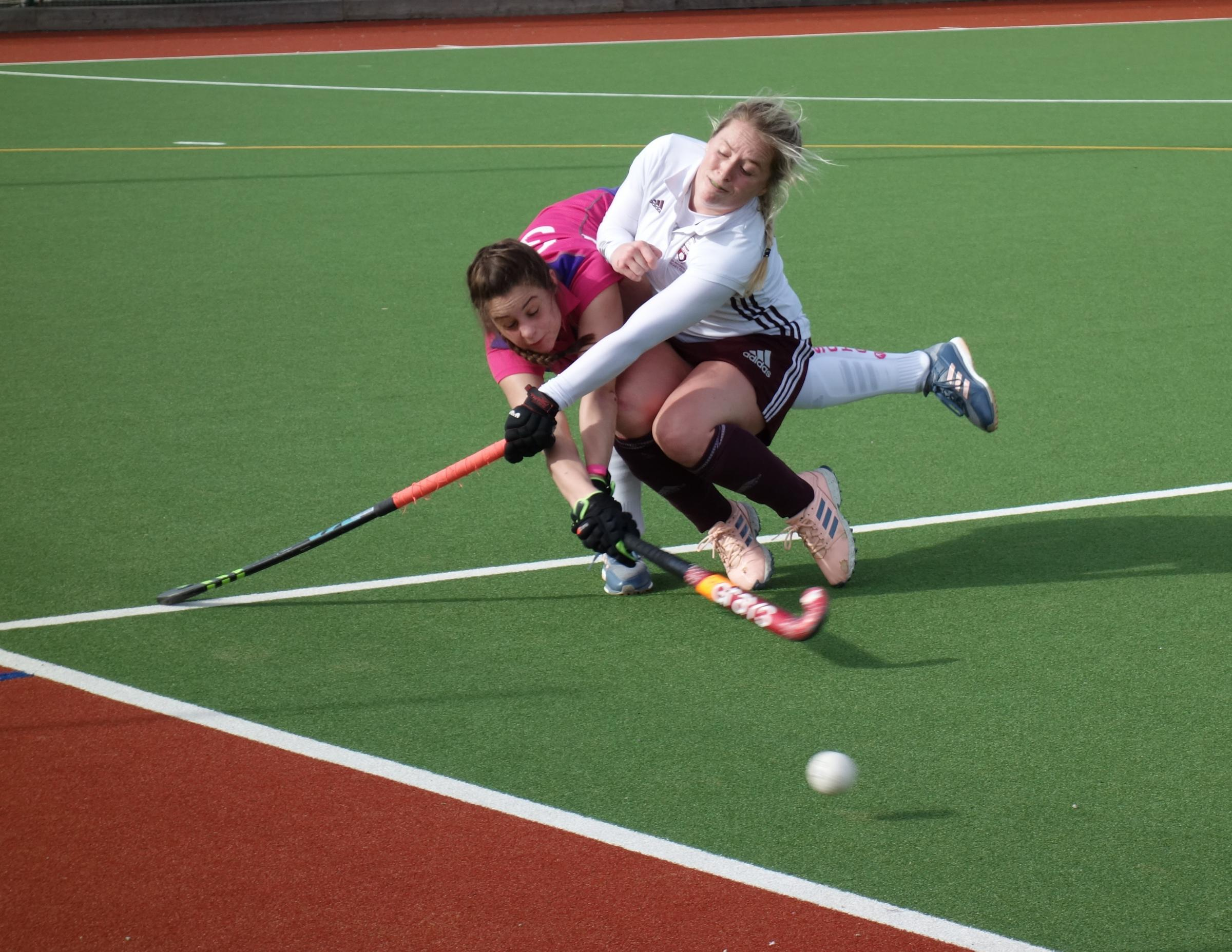 Ben Rhydding's Kate Wood tackles Elinor Thomas of Sutton Colfield