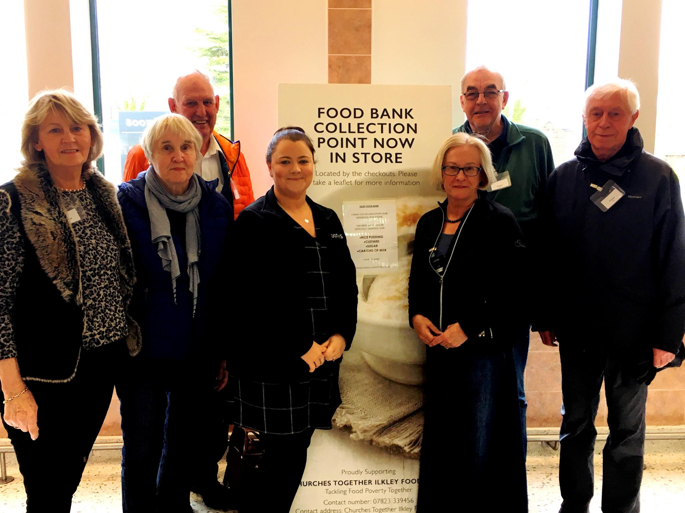 Rachel Costello, Manager of Booths, Ilkley (centre left) with some of the Food Bank Volunteers pictured in store following their training.