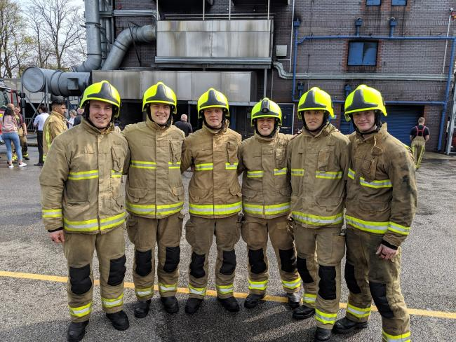 Newly qualified on-call firefighters Sam Hogston (third from right) and Lewis Mitchell (right)