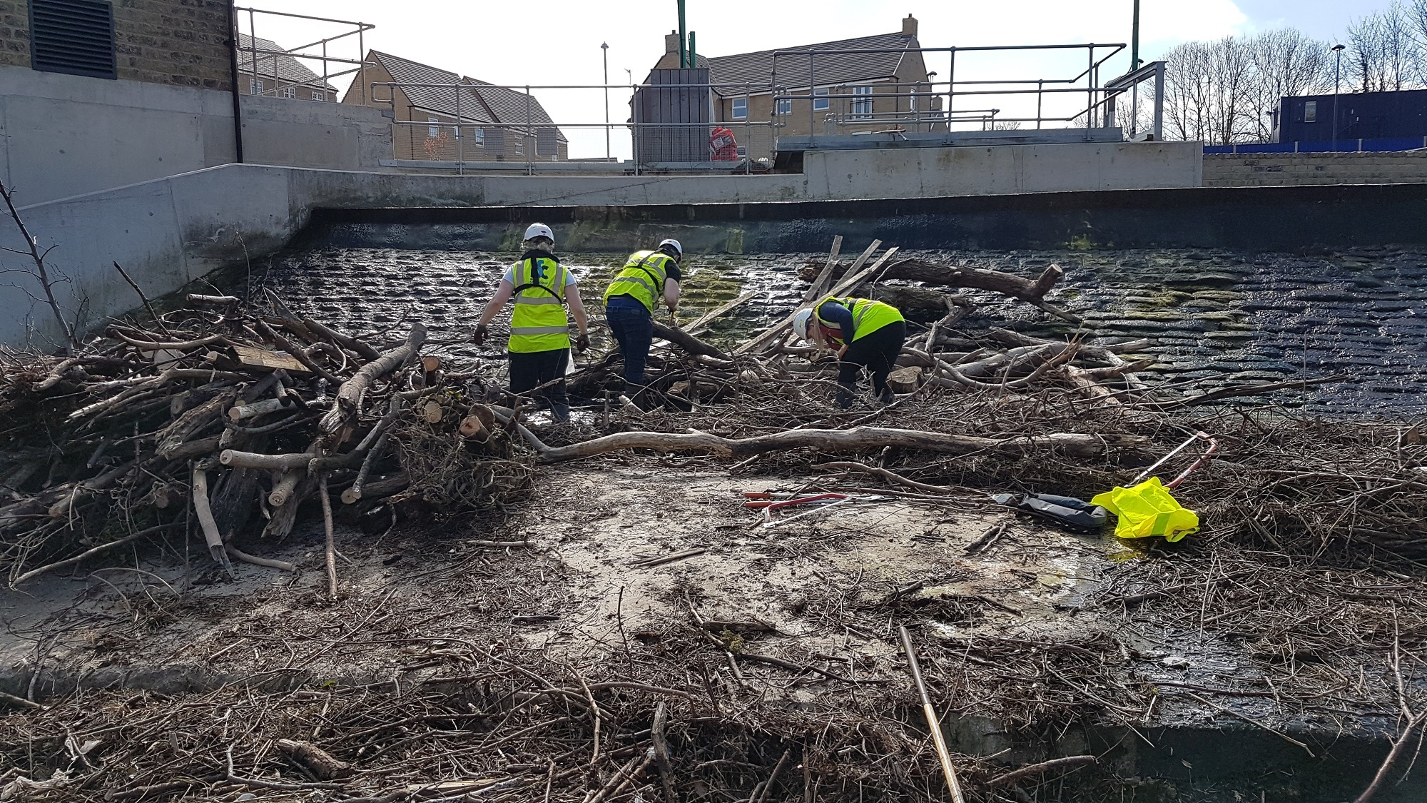 Volunteers clearing debris from Otley weir during a previous river clean-up day