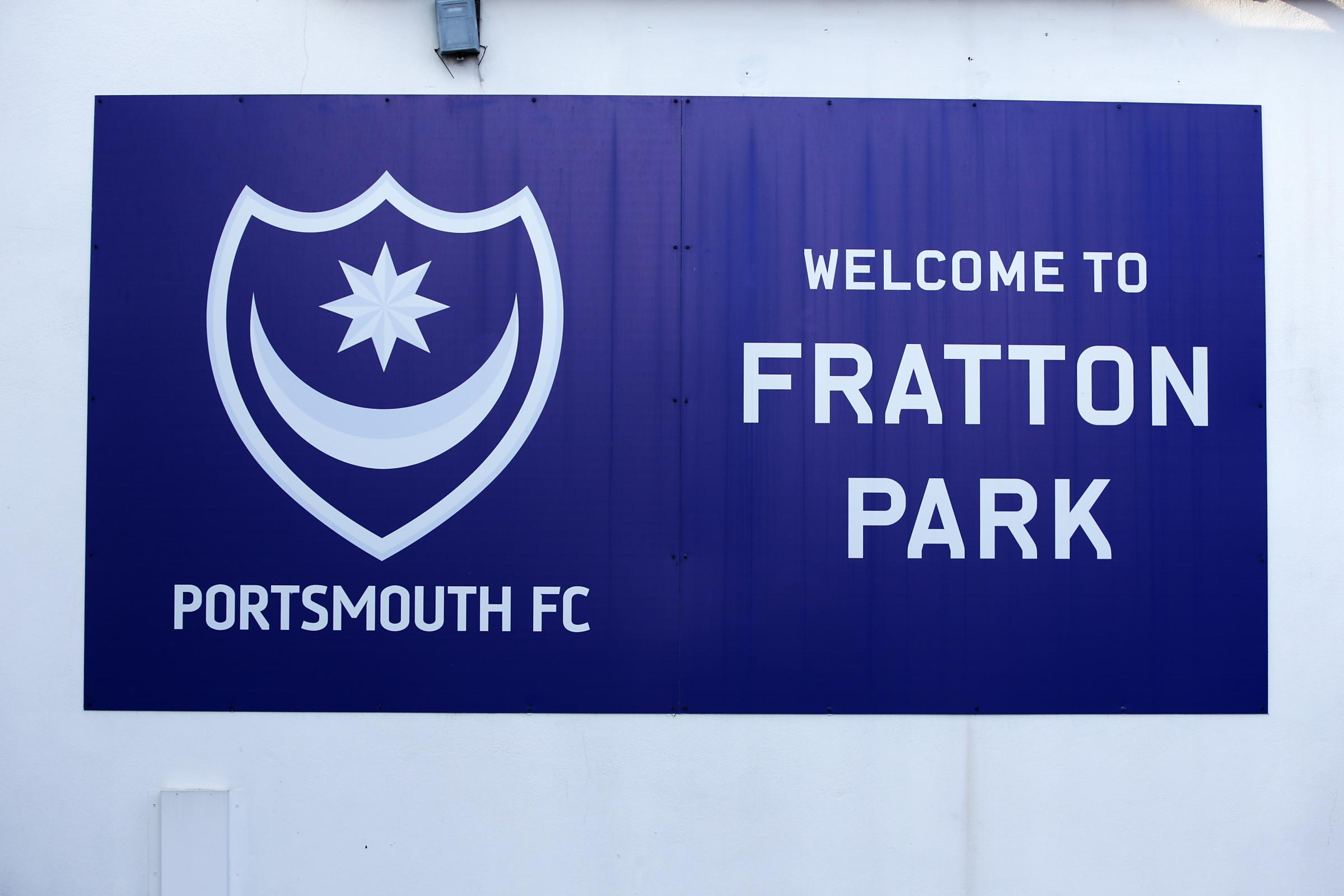 Police have made an arrest after threats were made to kill spectators at Fratton Park