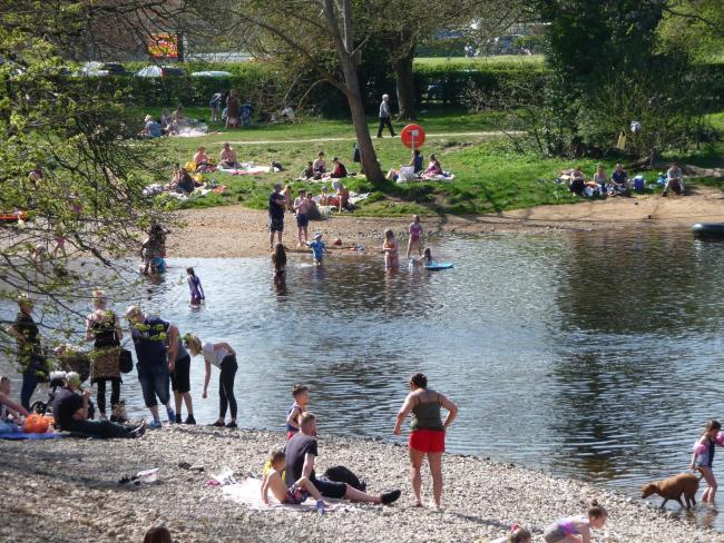 People bathing in the River Wharfe in Ilkley over Easter 2019